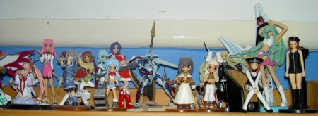 The top of one of my shelves full of manga.