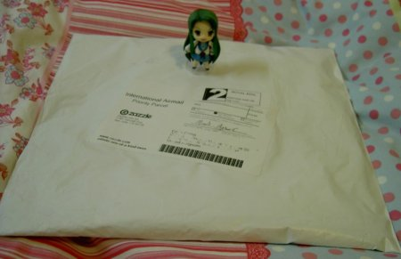 Tsuruya-san wonders what could be inside.... (Notice scrambled address lol)