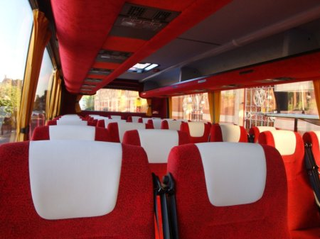 The inside of the bus. Very red.