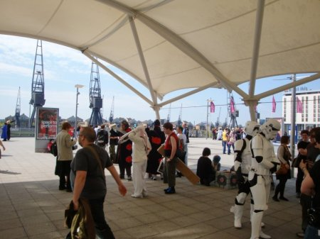 The shadey area outside the entrance to the excel center. Where some cosplayers gathered. Lots more on the grassy hilly areas close by too.