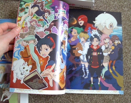 Inside the artbook, lovely glossy pages, sorry about the quality of the photos..